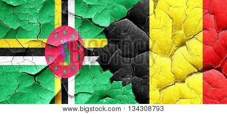 Dominica flag with Belgium flag on a grunge cracked wall