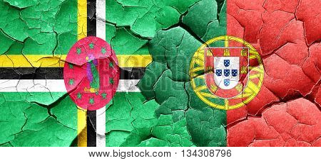 Dominica flag with Portugal flag on a grunge cracked wall
