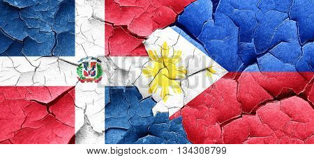 dominican republic flag with Philippines flag on a grunge cracke