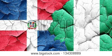 dominican republic flag with Nigeria flag on a grunge cracked wa