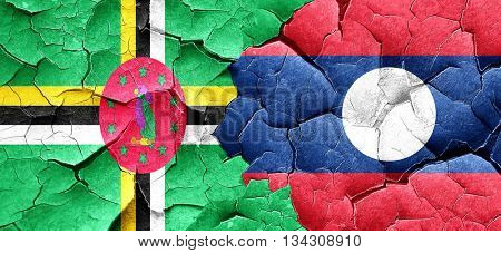 Dominica flag with Laos flag on a grunge cracked wall