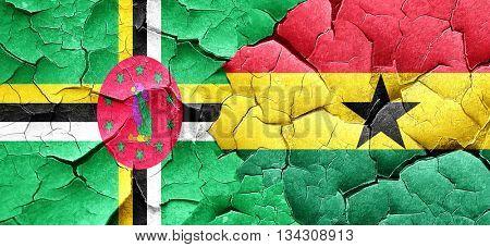 Dominica flag with Ghana flag on a grunge cracked wall