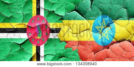 Dominica flag with Ethiopia flag on a grunge cracked wall