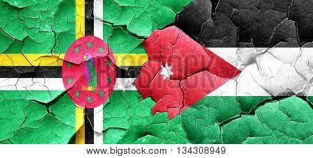 Dominica flag with Jordan flag on a grunge cracked wall