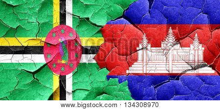 Dominica flag with Cambodia flag on a grunge cracked wall