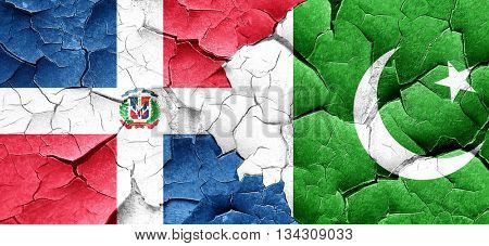 dominican republic flag with Pakistan flag on a grunge cracked w