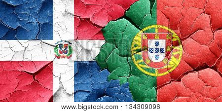 dominican republic flag with Portugal flag on a grunge cracked w