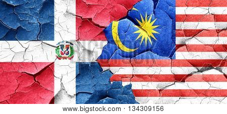 dominican republic flag with Malaysia flag on a grunge cracked w