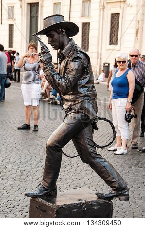 ROME, ITALY - MAY 12, 2012: Street artist man wear like cowboy on Navona square in Rome