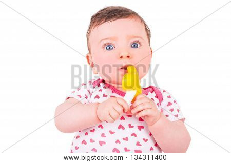 Baby girl with rattle teether toy on white background.