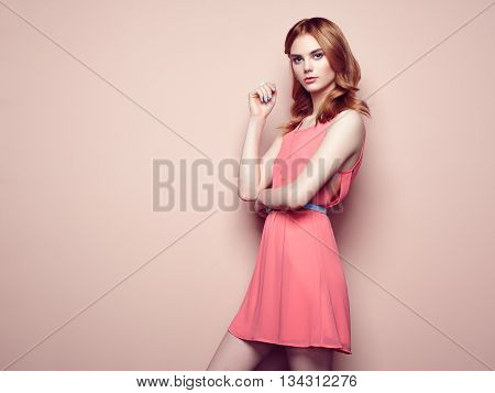 Fashion portrait of beautiful young woman in a summer dress. Beauty spring photo