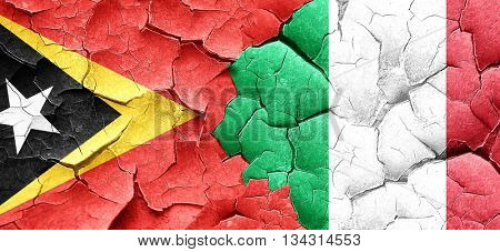 east timor flag with Italy flag on a grunge cracked wall