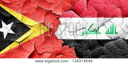east timor flag with Iraq flag on a grunge cracked wall