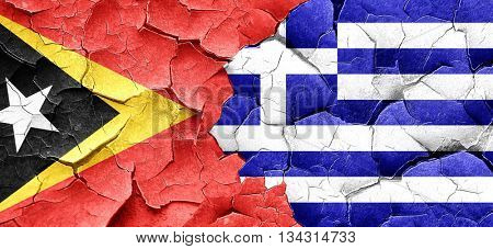 east timor flag with Greece flag on a grunge cracked wall