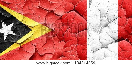east timor flag with Peru flag on a grunge cracked wall