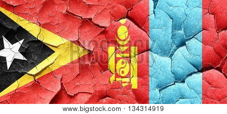 east timor flag with Mongolia flag on a grunge cracked wall