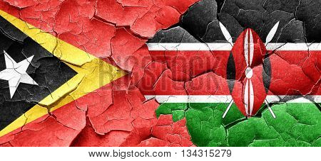 east timor flag with Kenya flag on a grunge cracked wall