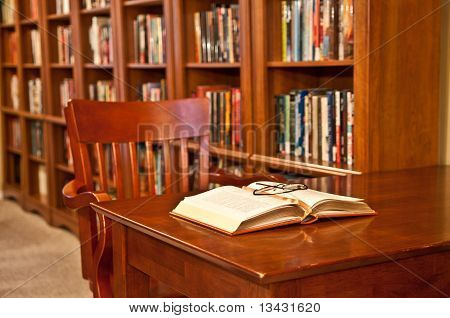 Open Book On Table In Library