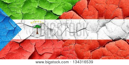 Equatorial guinea flag with Austria flag on a grunge cracked wal