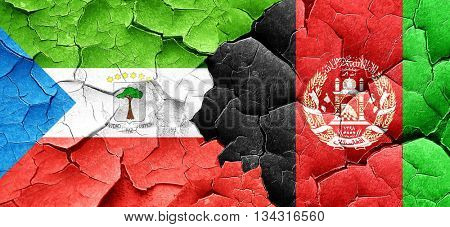 Equatorial guinea flag with afghanistan flag on a grunge cracked