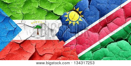 Equatorial guinea flag with Namibia flag on a grunge cracked wal