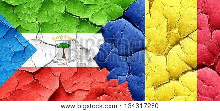 Equatorial guinea flag with Romania flag on a grunge cracked wal