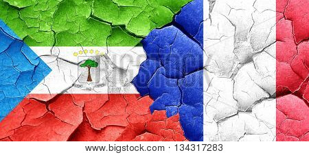 Equatorial guinea flag with France flag on a grunge cracked wall