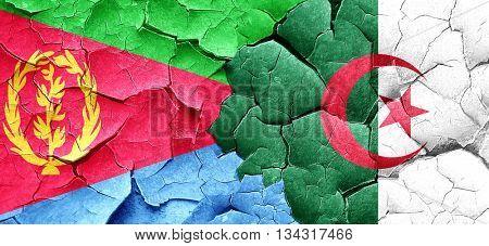 Eritrea flag with Algeria flag on a grunge cracked wall