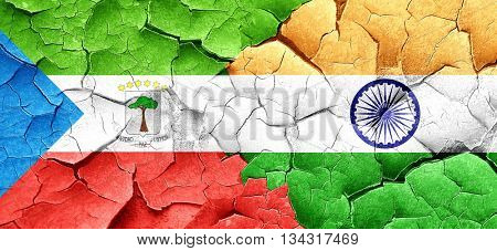 Equatorial guinea flag with India flag on a grunge cracked wall