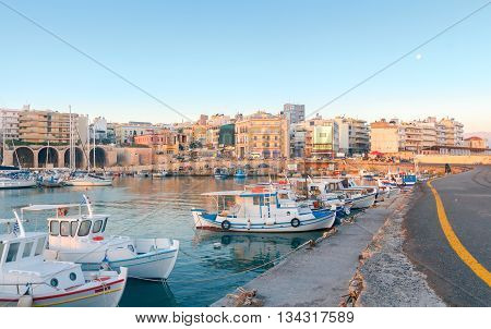 Fishing multi-colored boats in the old harbor of Heraklion in early sunny morning. Crete. Greece.