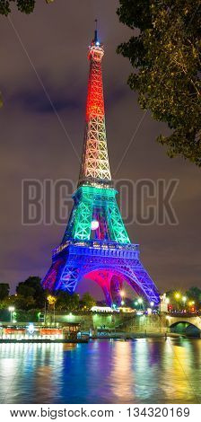 Paris; France-June 13 2016 : The Eiffel tower lit up in rainbow colors for solidarity with the LGBT community after the Orlando terror attack.