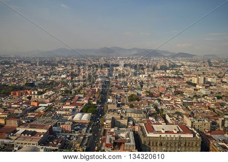 The view of the Mexico city from the top of the Latin American tower with the mountains on the background Mexico