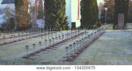 Cemetery with lamps grave light red lamp death