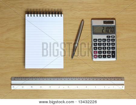 Notebook Calculator Ruler And Pen On Desk