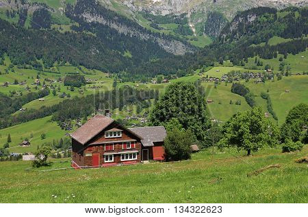 Timber house and rural landscape in the Toggenburg valley. Switzerland.