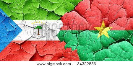 Equatorial guinea flag with Burkina Faso flag on a grunge cracke