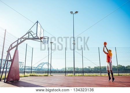 African american basketball player scoring a point.