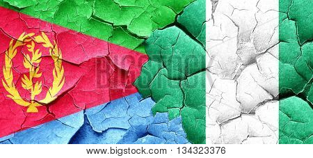 Eritrea flag with Nigeria flag on a grunge cracked wall