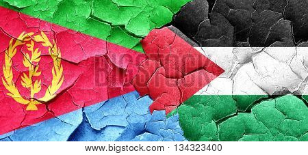 Eritrea flag with Palestine flag on a grunge cracked wall