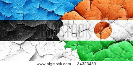estonia flag with Niger flag on a grunge cracked wall