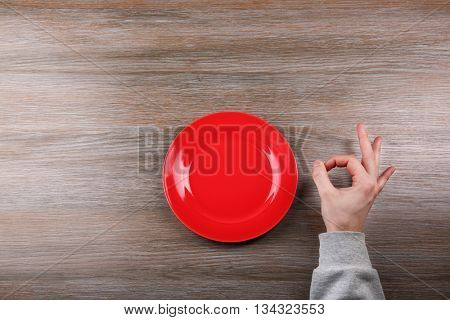 Man making gesture OK. Hunger concept