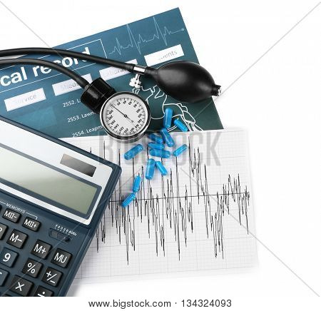 Calculator and tonometer on light background