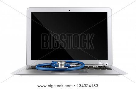 Stethoscope on laptop, isolated on white