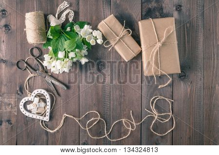 Bouquet Of Lwhite Flowers On A Wooden Rustic Table