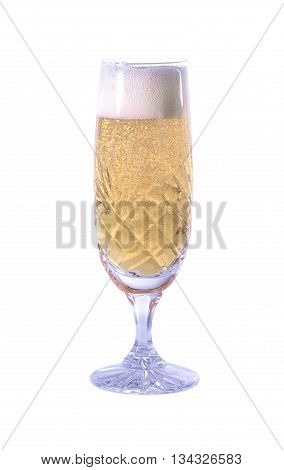 Champagne fizzing in a glass on a plain background