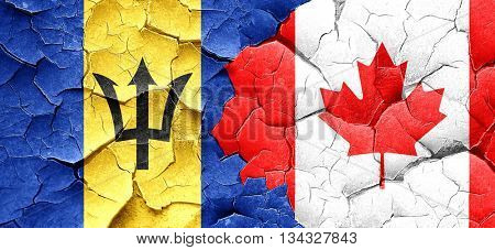 Barbados flag with Canada flag on a grunge cracked wall