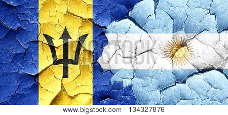 Barbados flag with Argentine flag on a grunge cracked wall