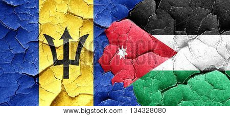 Barbados flag with Jordan flag on a grunge cracked wall