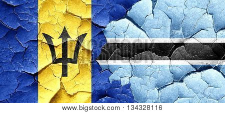 Barbados flag with Botswana flag on a grunge cracked wall