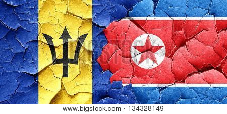 Barbados flag with North Korea flag on a grunge cracked wall